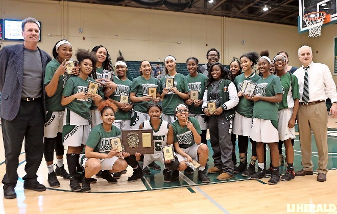 Elmont repeated as Nassau Class A girls' basketball champions last Saturday with a convincing 75-44 win over North Shore at Farmingdale State College.