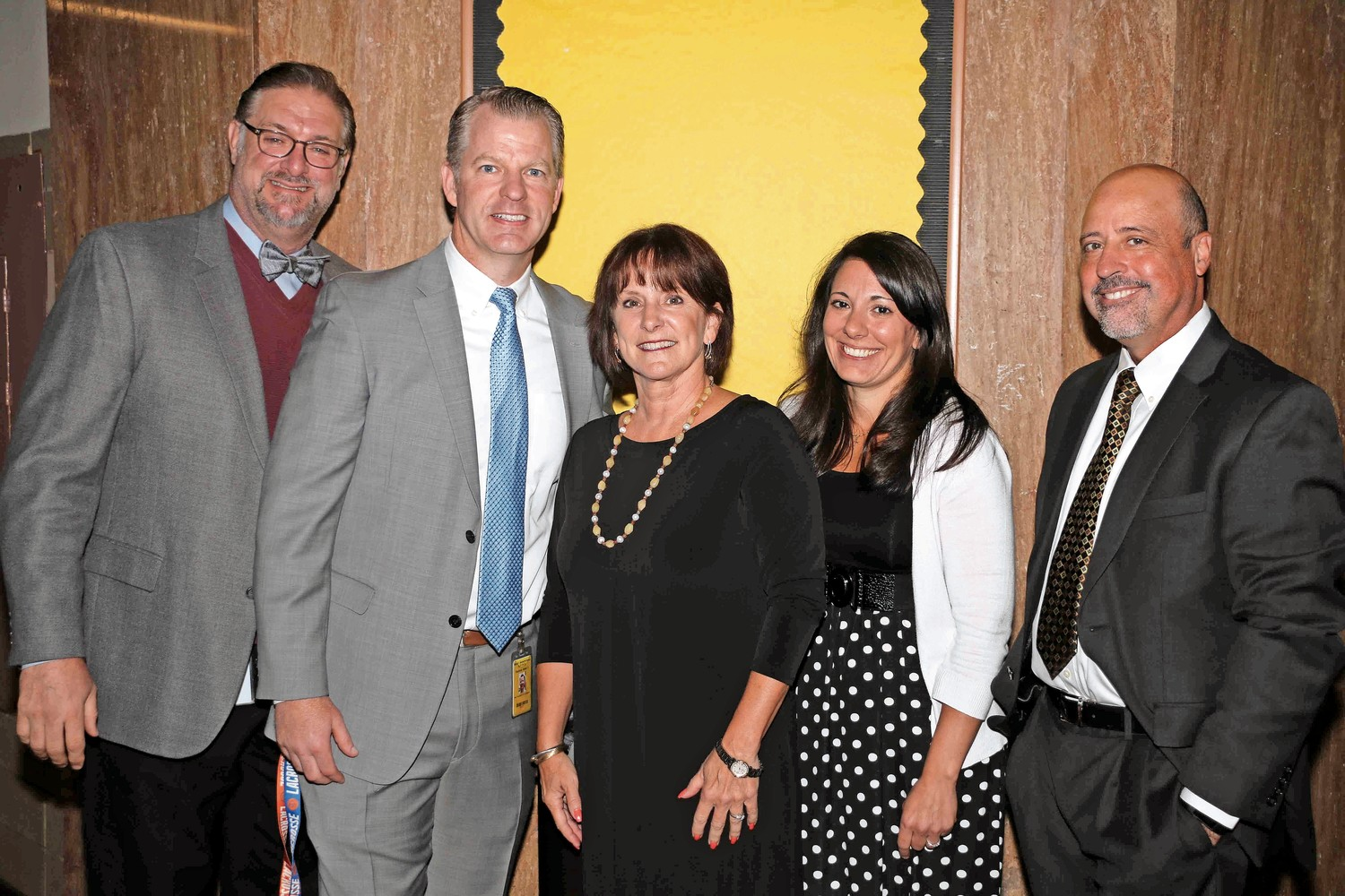 Assistant Superintendent for Curriculum and Instruction Daniel Rehman, far left, West Hempstead High Assistant Principal Adam Hopkins, Superintendent Patricia Sullivan-Kriss and West Hempstead High School Assistant Principal Michele Lambo-Maron congratulated Escobar on his retirement.