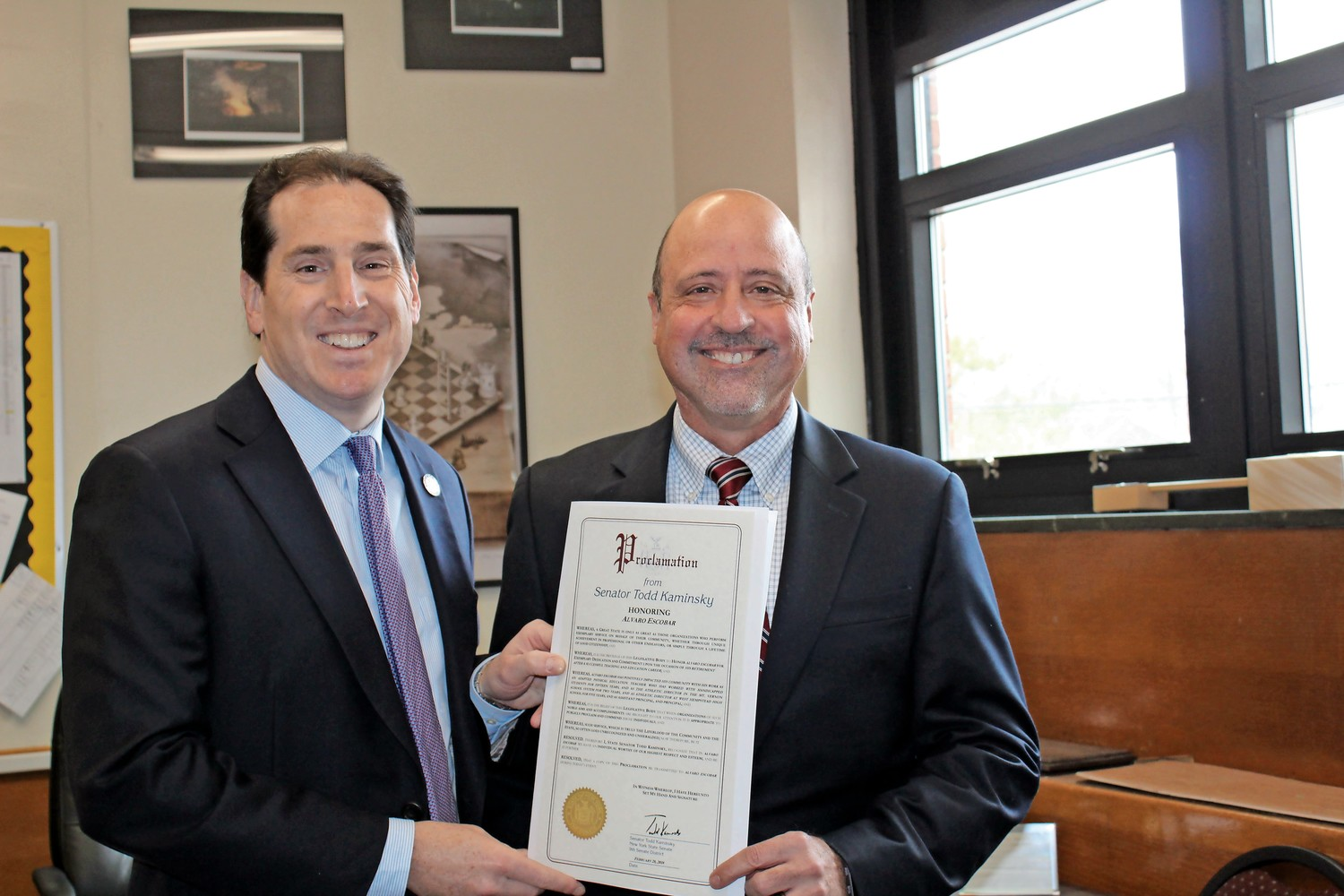 State Sen. Todd Kaminsky presented a proclamation to West Hempstead High School Principal Alvaro Escobar for his 18 years in the West Hempstead School District on Feb. 26.