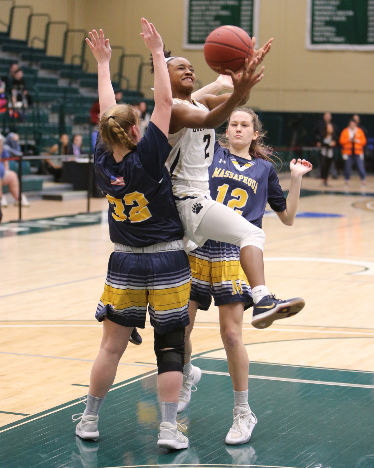 Baldwin senior Aziah Hudson drove between Massapequa's Kathleen Doherty, No. 12, and Jessica Woods, on the way to a 14-point performance in the Nassau Class AA final.