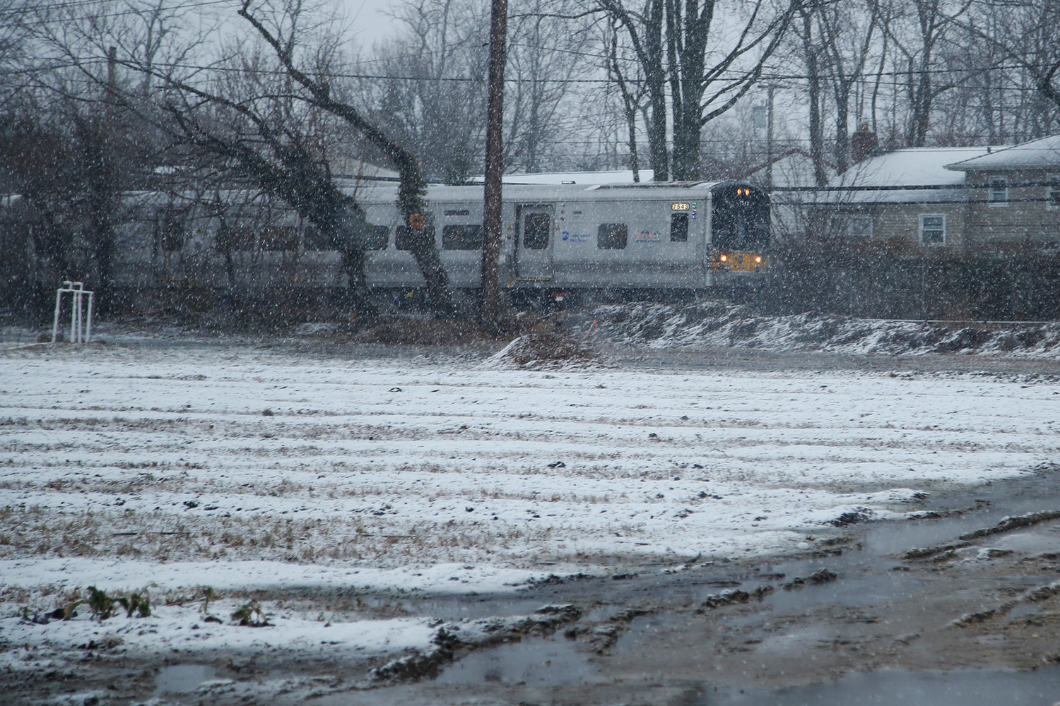 The West Hempstead branch of the Long Island Railroad travels west past Crossroads Farm in Malverne.