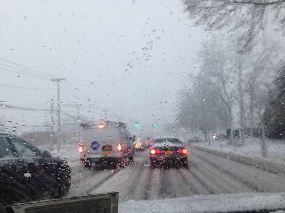 Heavy snow was falling across Nassau County on Wednesday afternoon, causing traffic to snarl on thoroughfares such as Merrick Avenue, seen here in East Meadow.