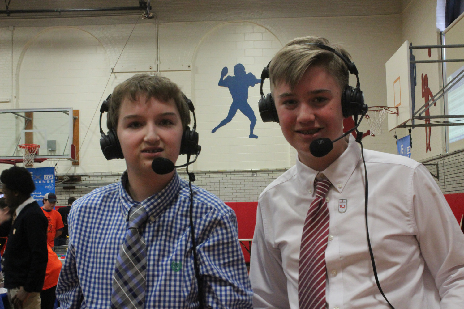 Seventh-grader Matthew Eckrich, left, and eighth-grader Jack Cashman called the competition from the sidelines for Channel 36.