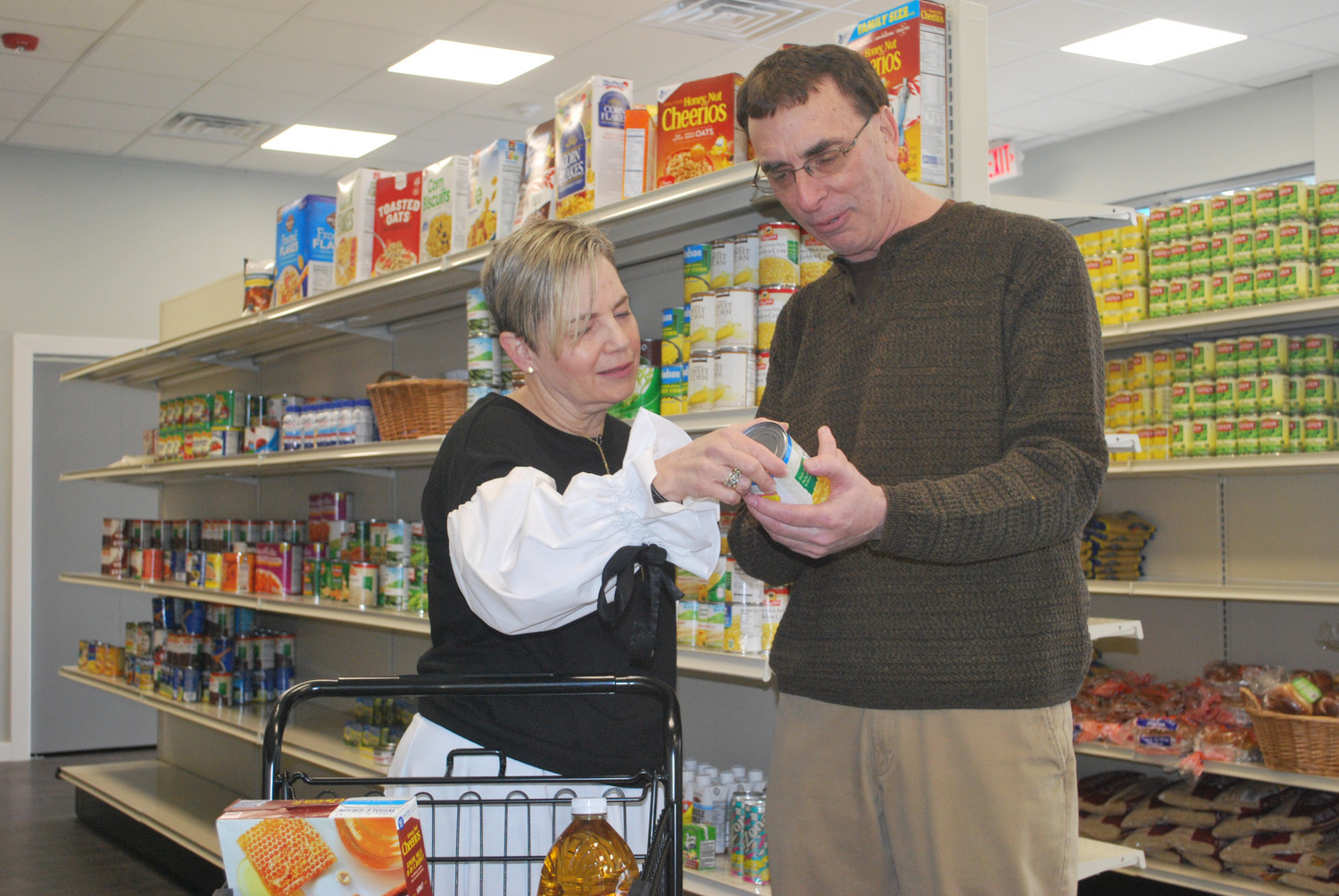 Stop & Shop is donating two tons of of kosher food earmarked for Passover to the Gural JCC Sustenance Center. Above, new JCC Executive Director Amy Mosery and predecessor Joel Block looked in the center last month.