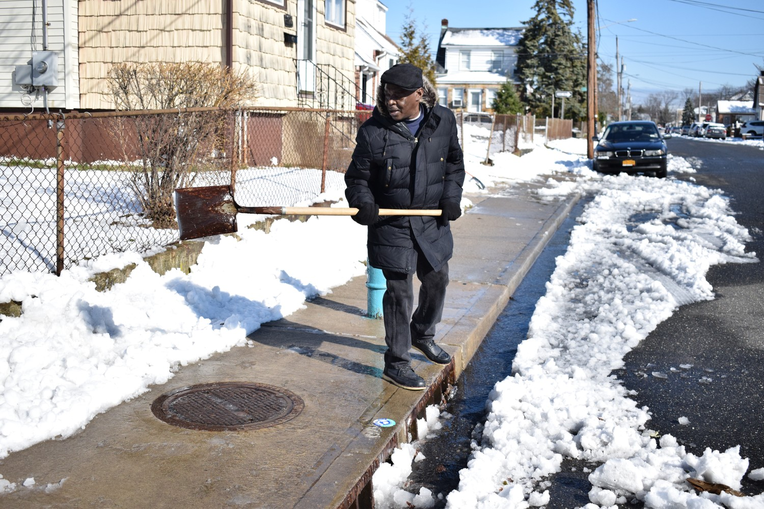 Resident Morgan Shervin cleared away snow on Evans Avenue in Elmont after the storm.