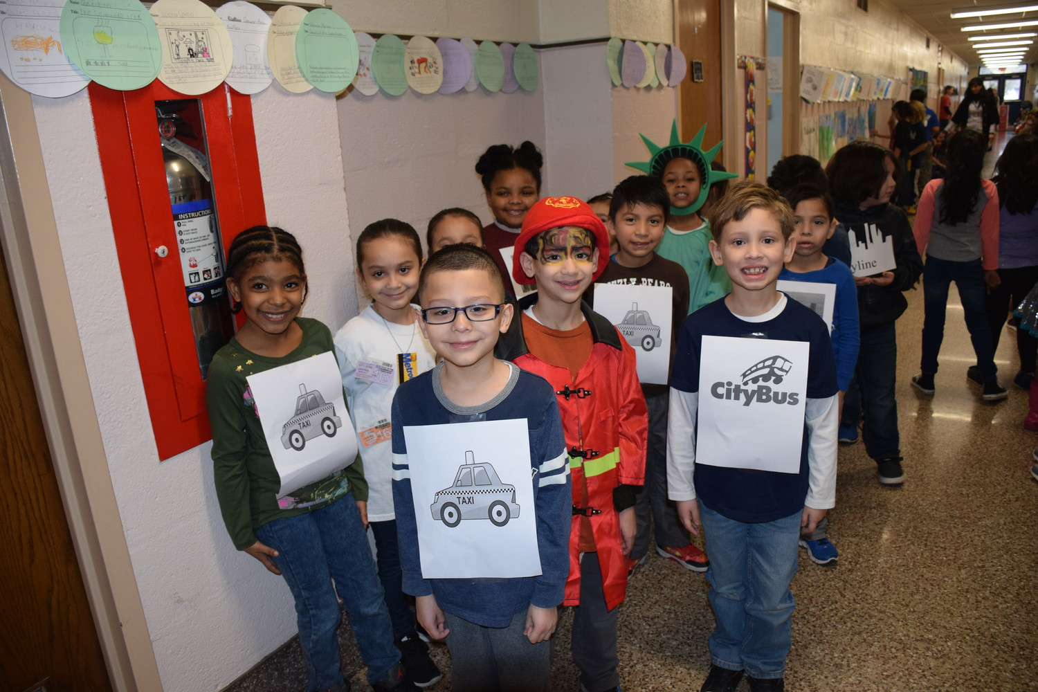 Kara Maguire's first-graders took part in the celebration as different forms of New York City transportation.