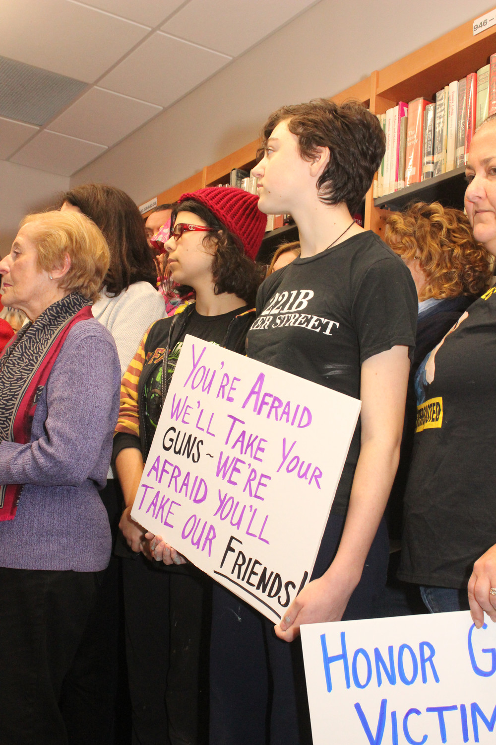 South Side High School student Katie Ralph displayed a placard at the news conference.