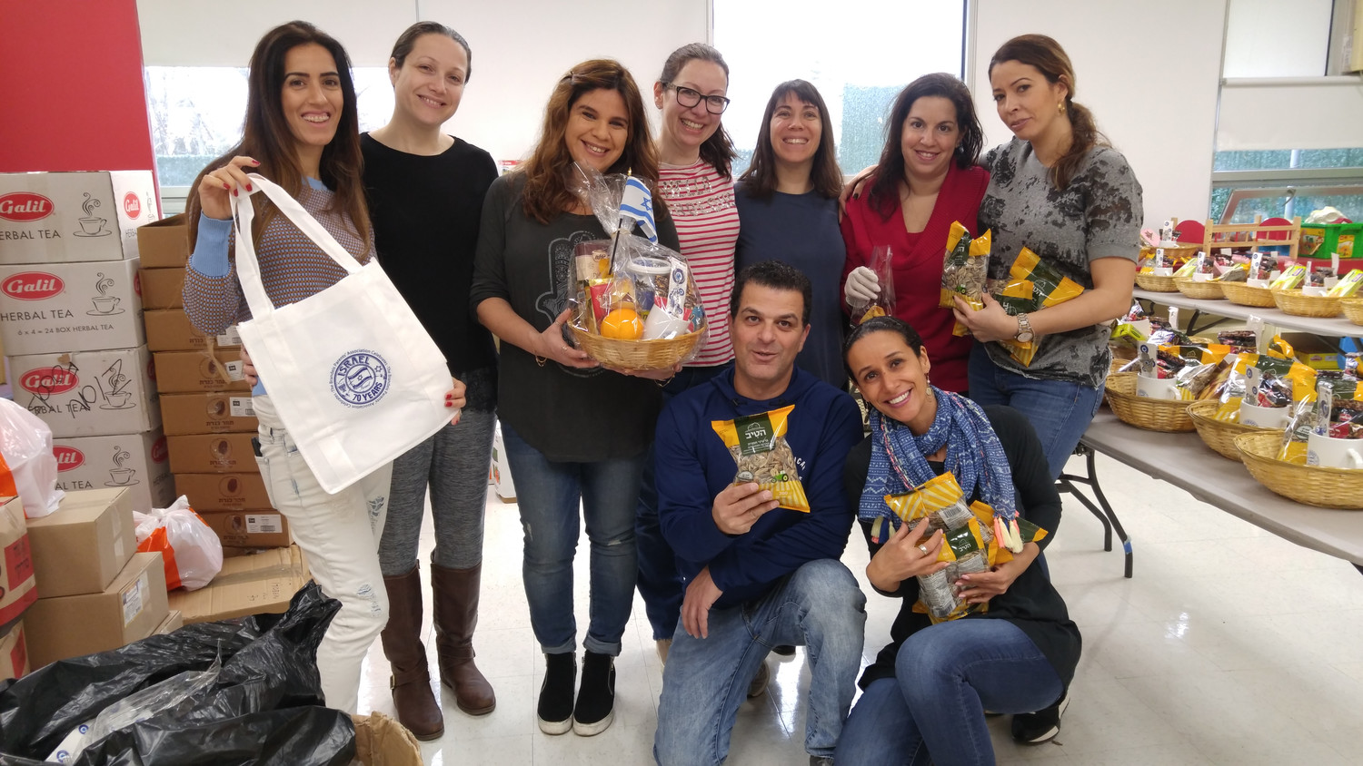 Members of the Brandeis School PTA packaged fruit basket given to members of the school community for Purim.