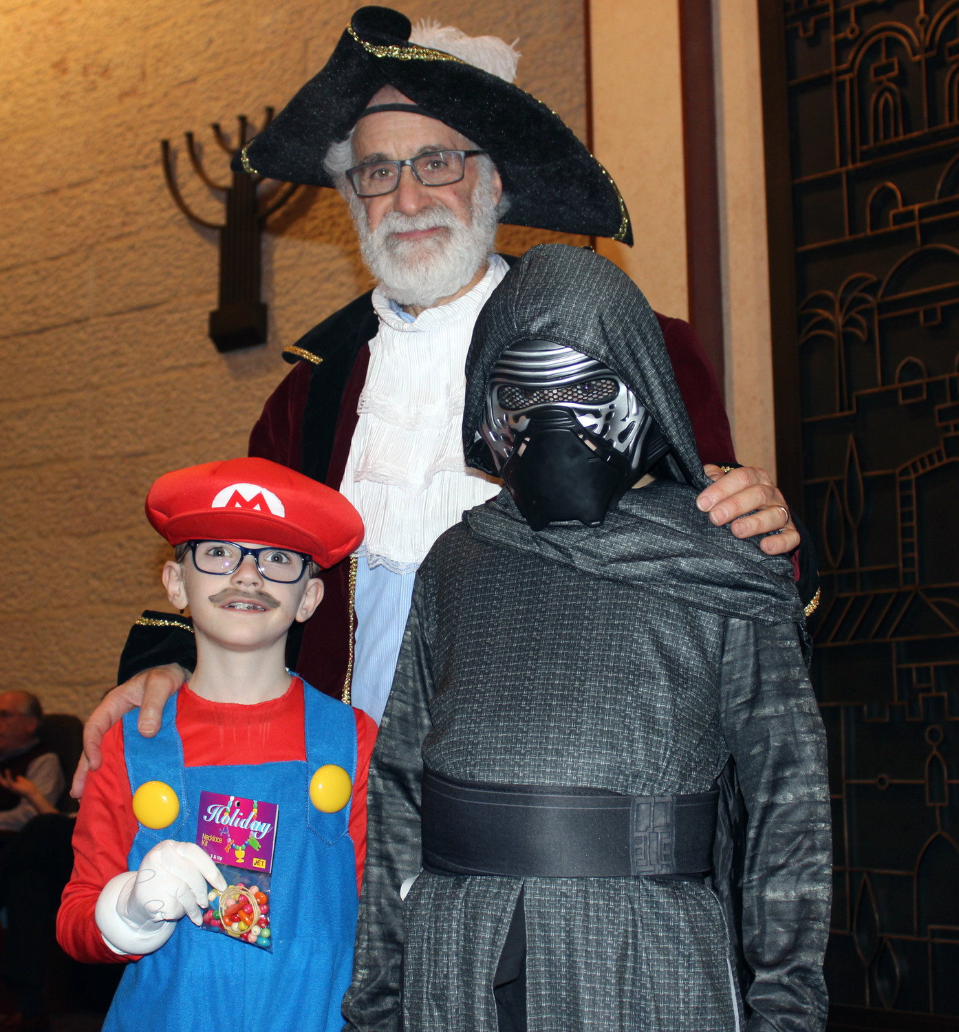 Prizes were also given to Matthew Feldman-Bates, 8, who dressed as the video-game character Mario, Seth Mawner, 10, left, who dressed as Kilo Ren from Star Wars. Both are pictured here with Rabbi Ronald Androphy.