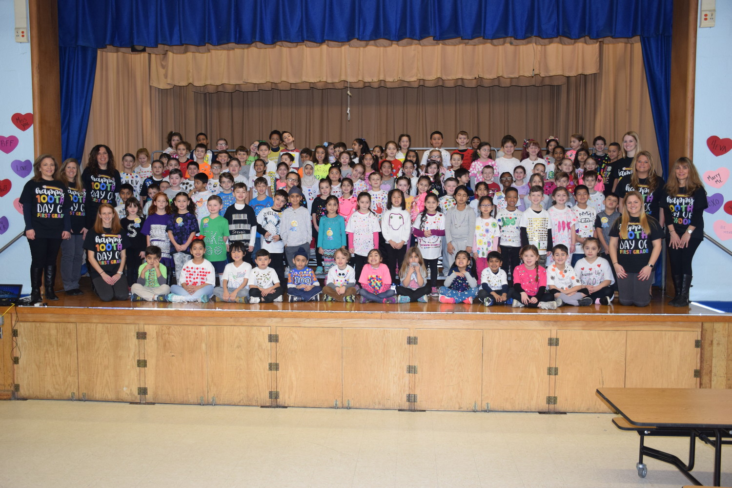 Bowling Green Elementary School first-graders commemorated the 100th day of school by sporting T-shirts bedecked with 100 various items.