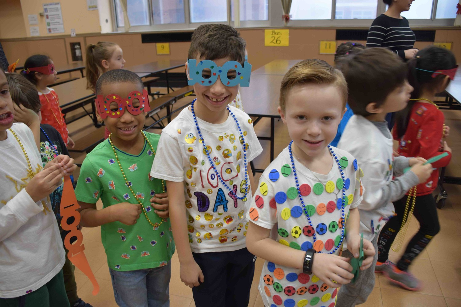 Barnum Woods Elementary School kindergartners accessorized their own shirts and glasses with the number 100 to signify the 100th day of school.