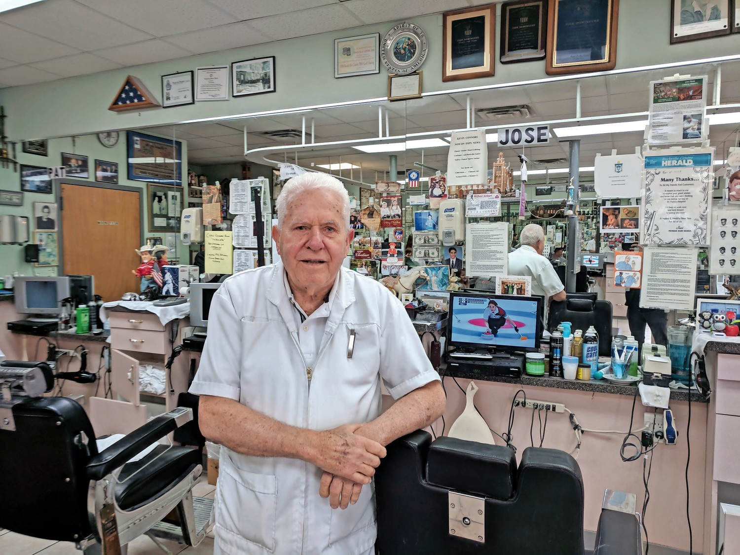 Jose Dominguez came to Rockville Centre from Cuba 50 years ago, and has spent those decades cutting hair for customers.