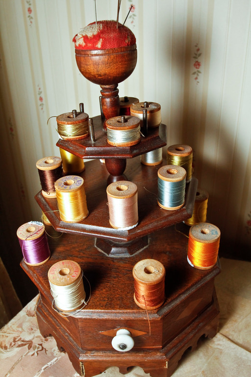 Various colored spools in the sewing room.