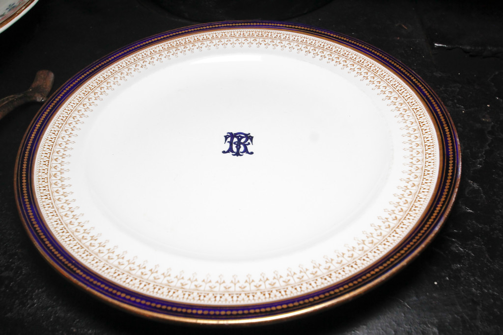 Plates engraved with TR's initials, which the family used while in the White House.