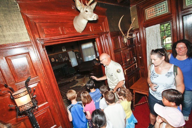 The students were fascinated by Teddy's Library during their tour.
