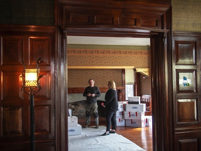 March 2015. Sue Sarna, curator of Sagamore Hill and project manager, speaks with Craig Oleszewski, Sr. Exhibit Specialist for National Parks Svc. N.E. Region in TR's Library during the restoration. Items are being unpacked and put back where they belong.