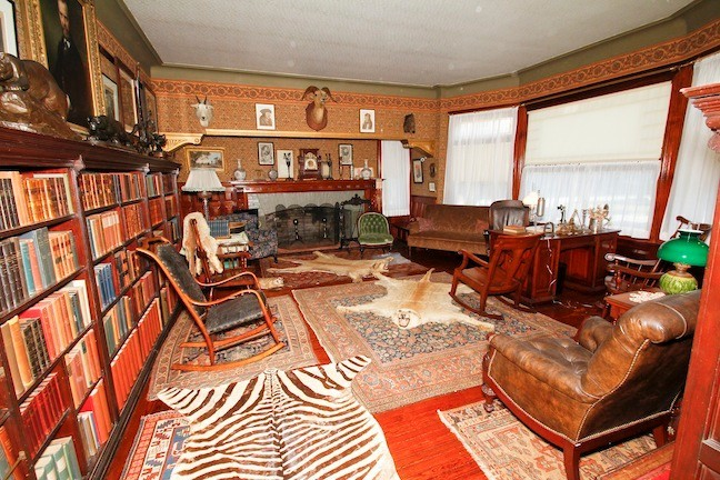 "June 2015. TR's Library is finally complete. Animal hides, the ""Ting Tang"" clock, hundreds of books and a large portrait of TR's father (that he never moved) made the him feel comfortable while working away at his desk"