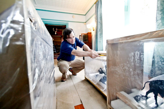 May 5, 2015. In the Drawing Room, George Hagerty cuts open one of the custom crafted shipping containers built to protect the bronze it holds inside.