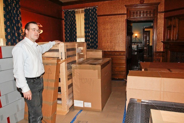 April 4, 2015. The Dining Room is full of boxes that were recently shipped back from Massachusettes. George Hagerty speaks about the special containers that were used which he had to build to ship some of the more fragile items.