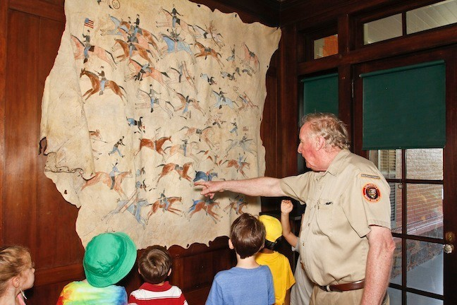 The children listened intently to Brendan Casey, a guide since 1994, as he shared information on the buffalo robe that was painted by Indians given to TR when he was out west. The robe depicts the Battle of Little Bighorn.