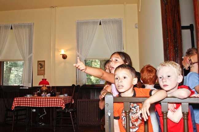 Garbriella Vergara points at one of the objects across the Kitchen which caught her and the boys,  Jefferson Gomez and Jaron Schatner's attention
