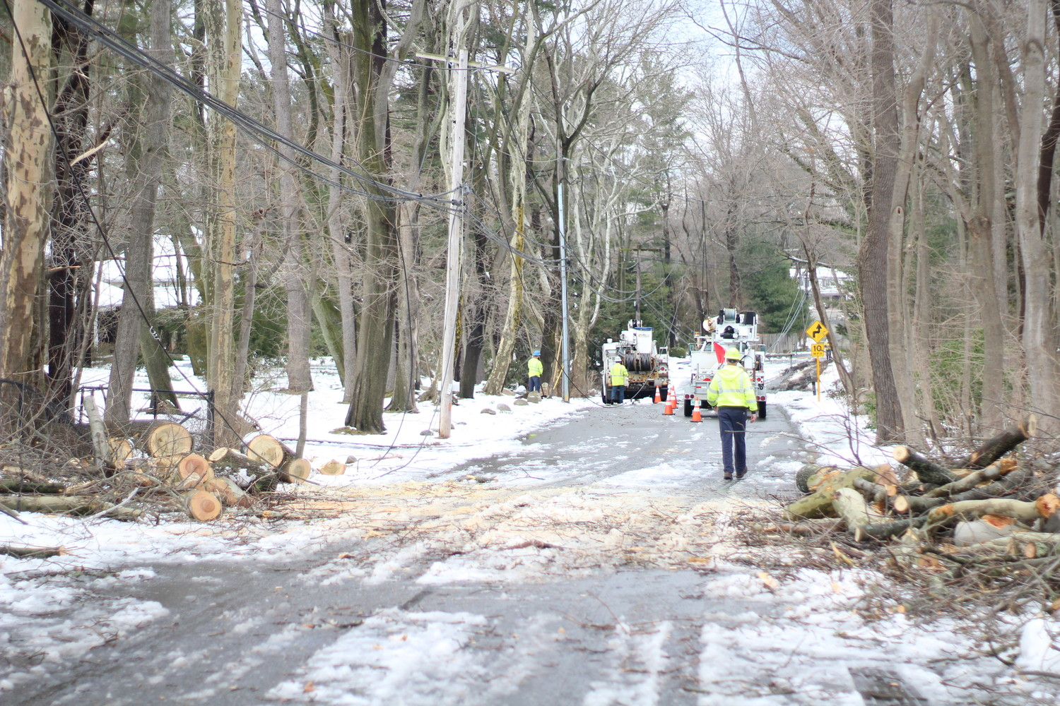 On Brookvale Lane in Glen Head, several downed trees and split poles knocked out power for the block. Clearing the road and rewiring power in the area was one of the thousands of jobs PSEG Long Island did after Winter Storm Quinn.
