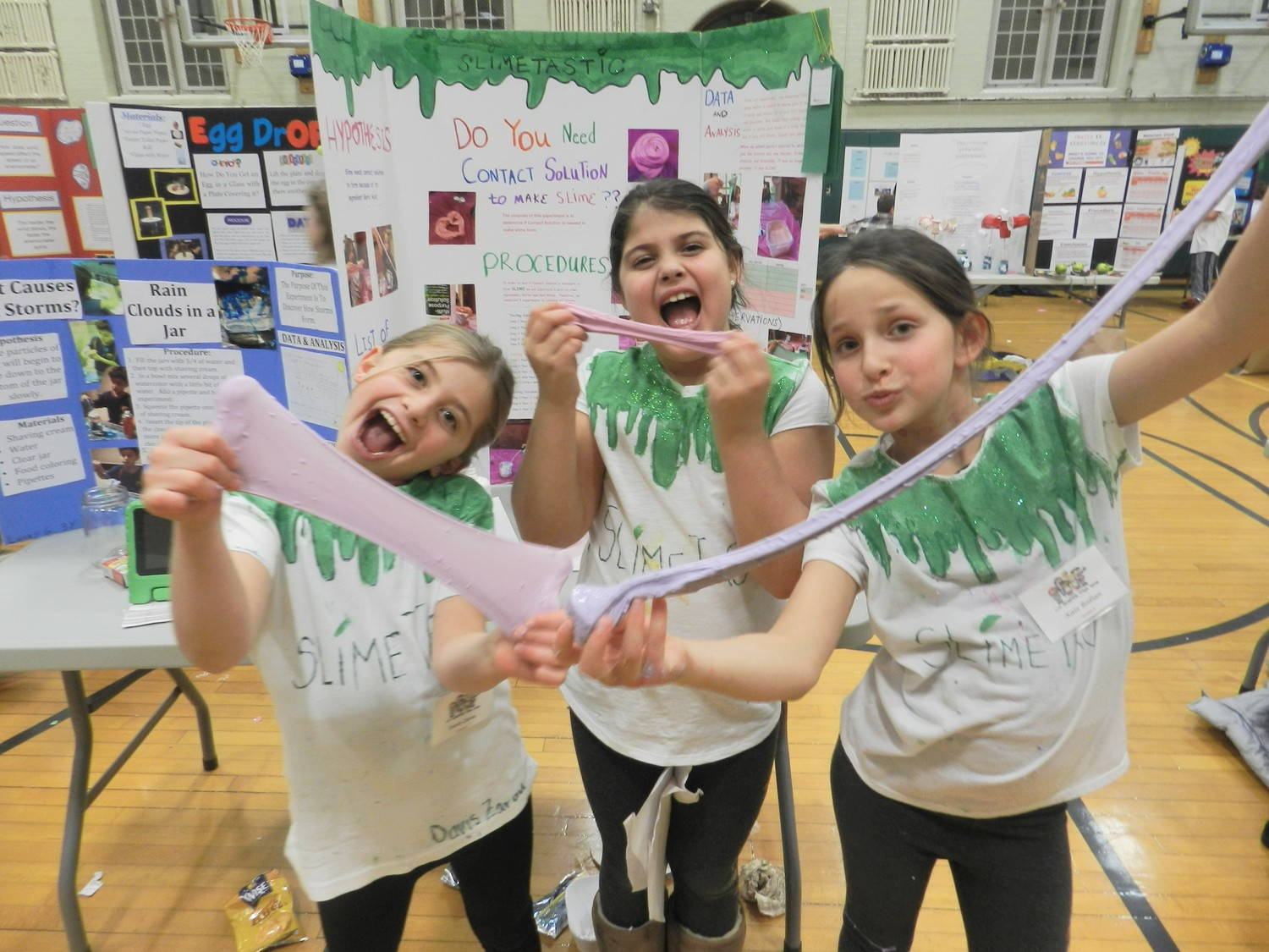 Third-graders, from left, Davis Zarou, Ellis Blair and Kate Bodian stretched slime to the limit in Locust Valley Intermediate's annual science fair.