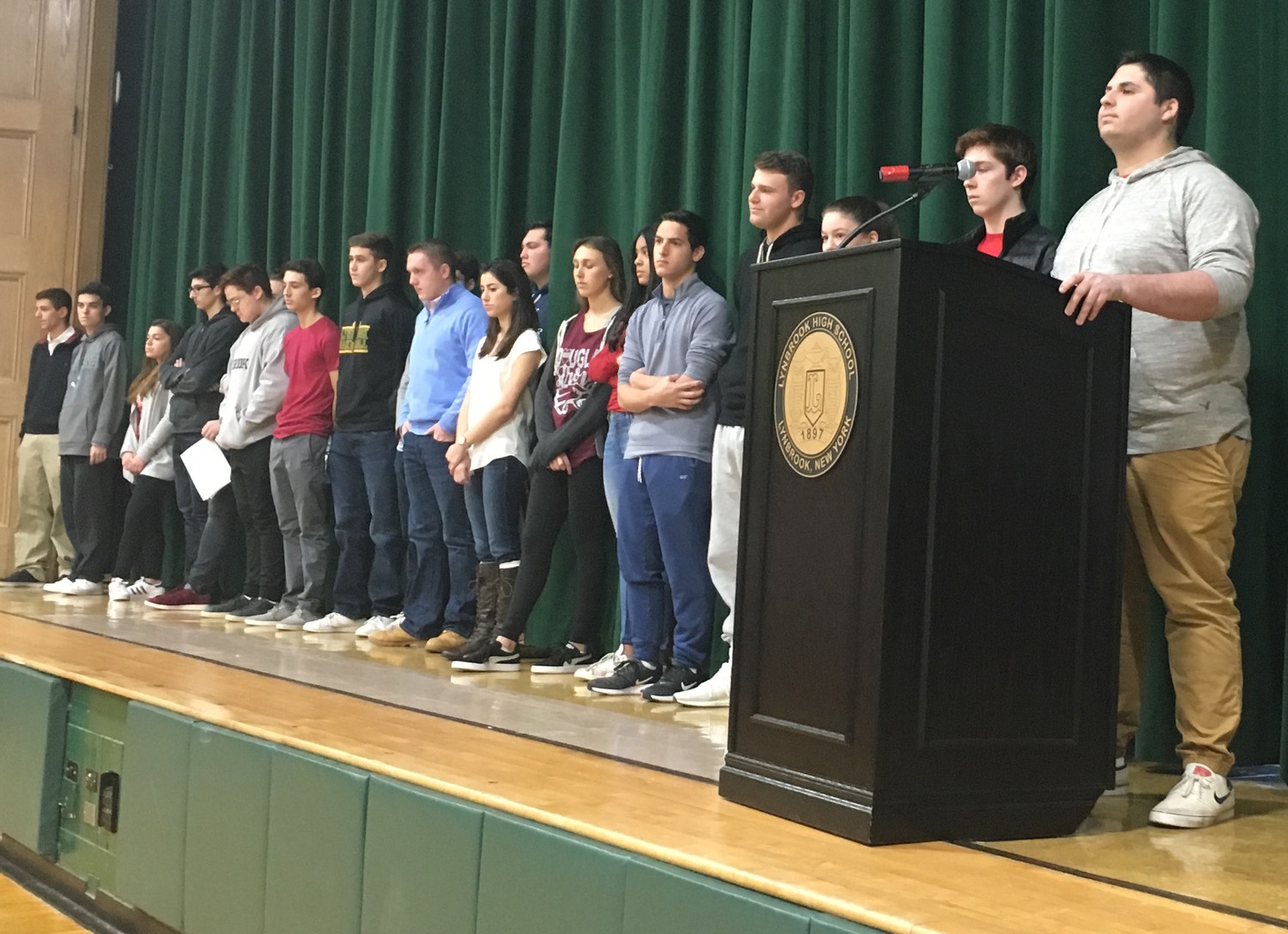 Lynbrook High School students stood for a moment of silence before a planned memorial ceremony to honor the 17 victims of the Marjory Stoneman Douglas High School mass shooting a month ago.