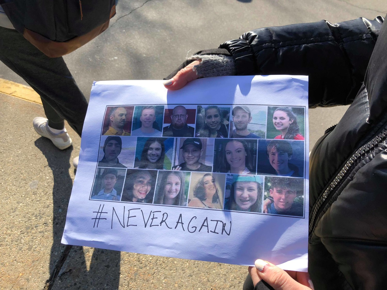 A student created a sign commemorating the victims of the Majory Stoneman Douglas shooting.