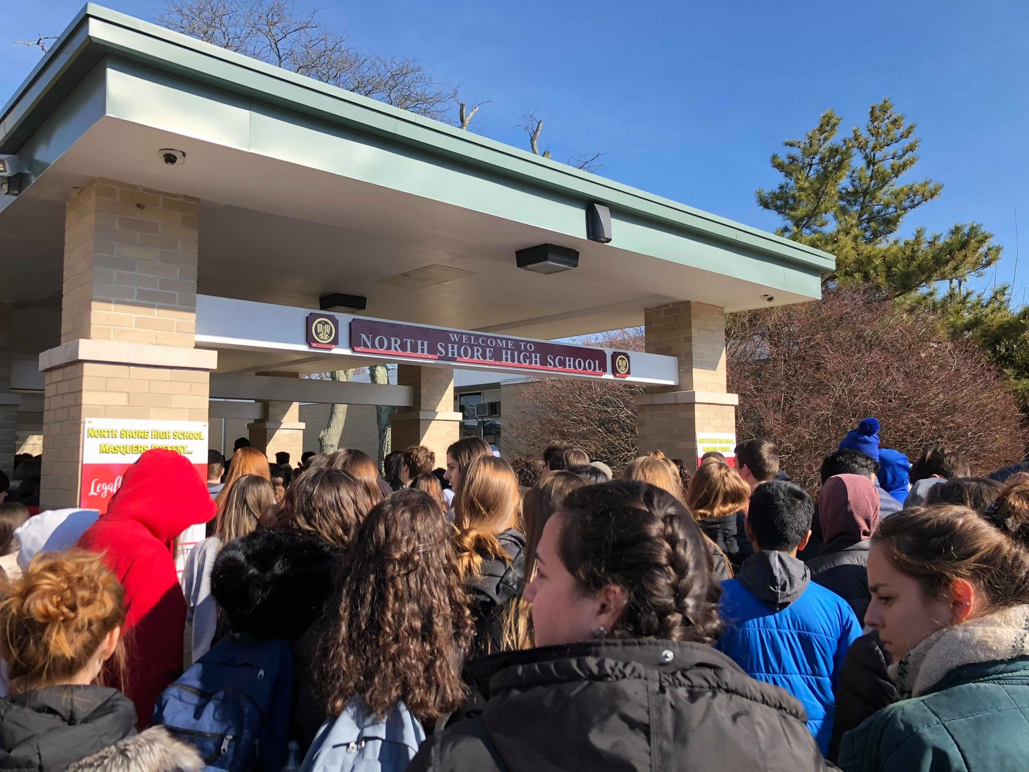 North Shore High School students flooded the outer perimeter of the school today to participate in the National School Walkout event.