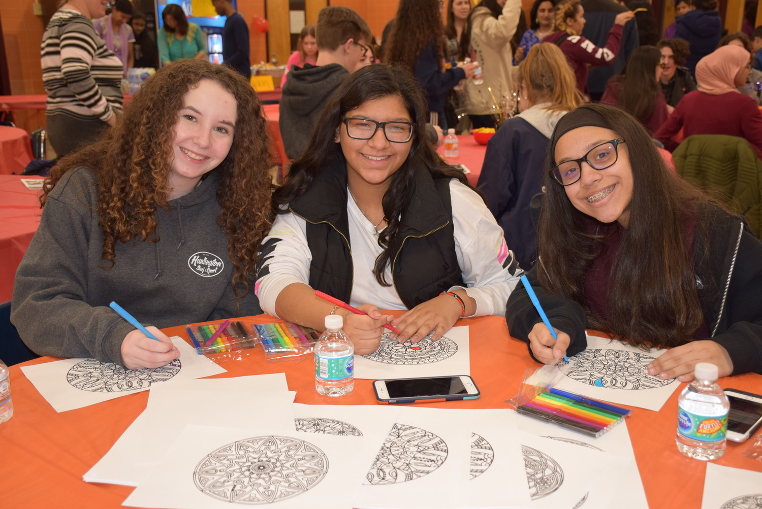 Katelyn Conte, far left, Kayla Bracamonte and Alyssa Olmo colored mandalas at Mepham High School's second annual Middle Eastern and South Asia Culture Night.