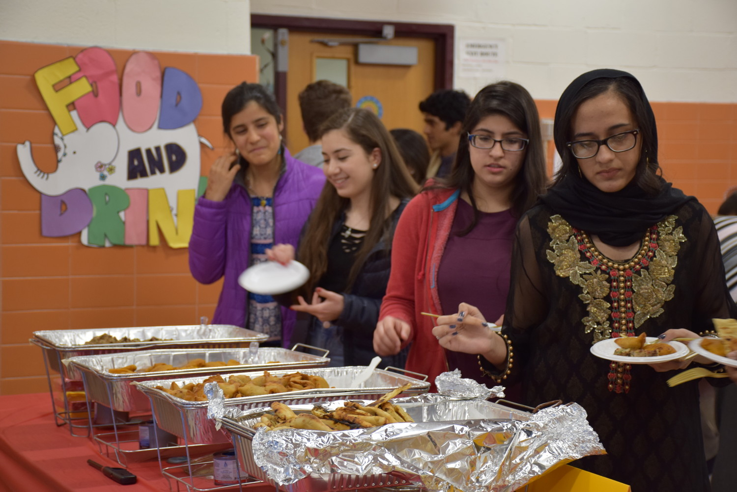 Traditional foods such as samosas, naan, kebabs and banana chips were served at the March 1 event.
