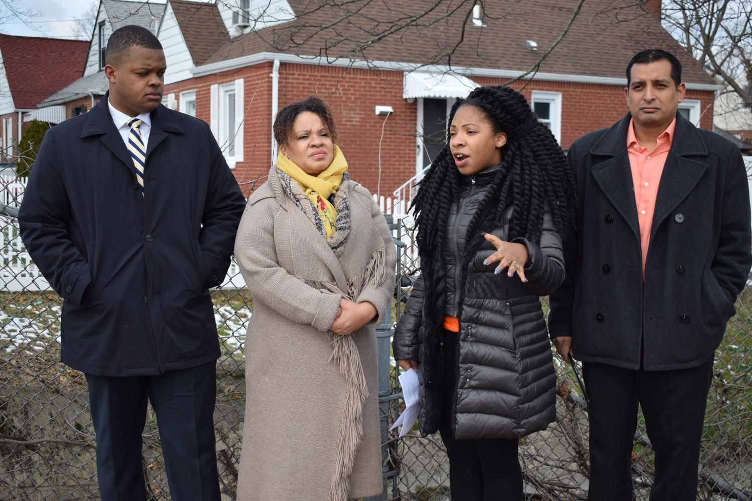 Community activists by the banks of Elmont Creek speak about cancer in their community. (Left to right) Congressional candidate Carl Achille, and activists Mimi Pierre-Johnson, Tamar Paoli and Victor Perez.