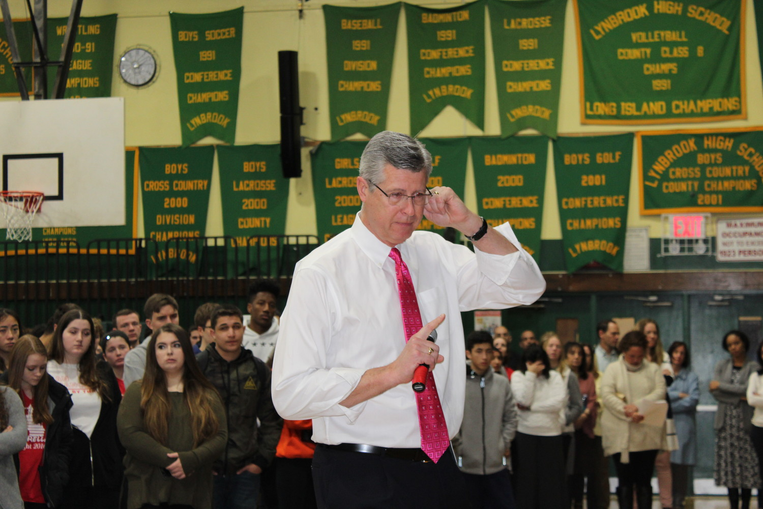 Principal Joseph Rainis was close to tears after the students read the victims' names and talked about their lives.