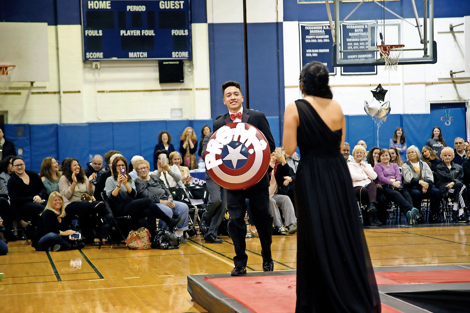 "Justin Salzar ""promposes"" to Casey Cataldo using Captain America's shield. (She said ""yes!"")"