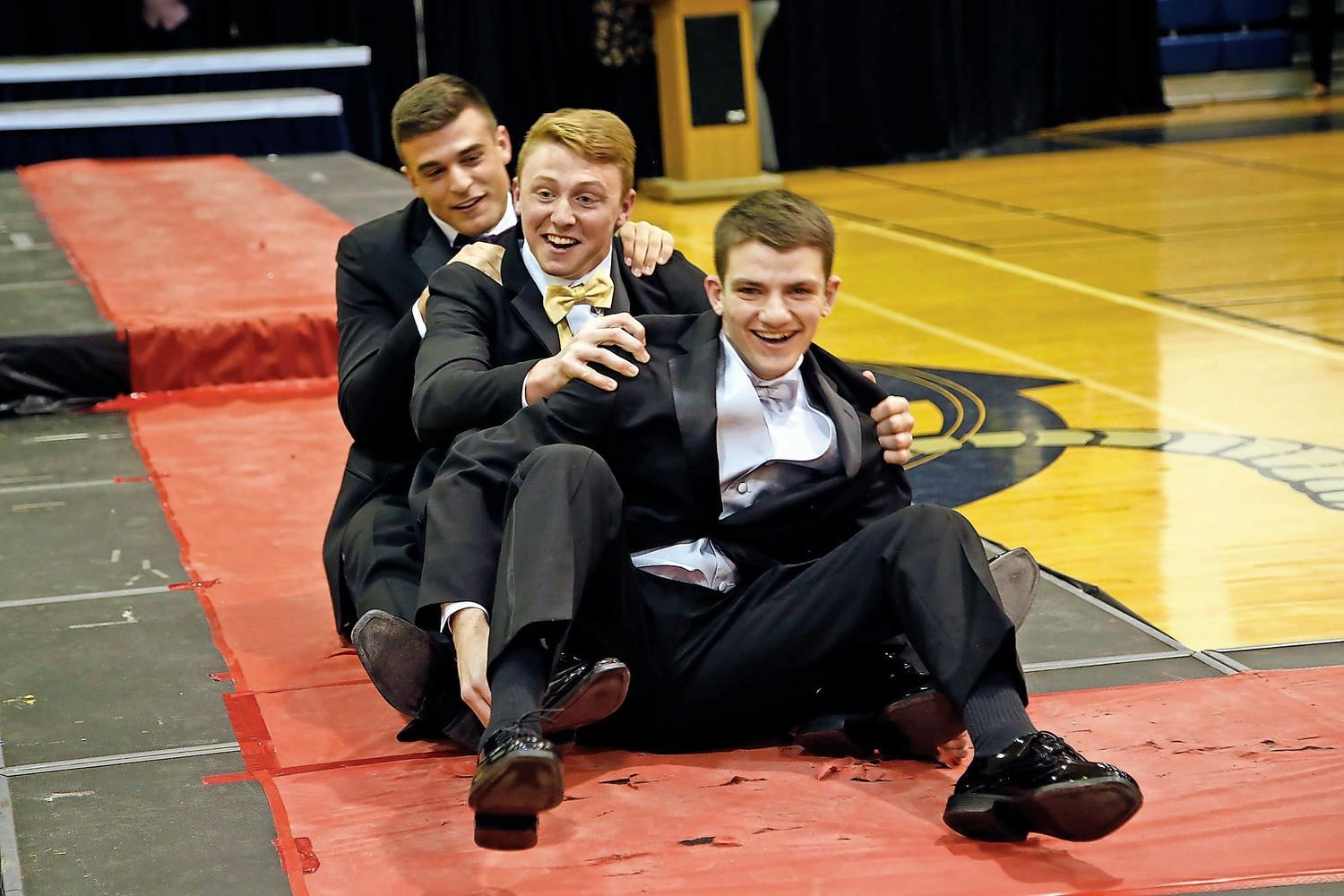 Charles Ward, front, Tommy Heuer and Dylan Judd take to the floor for an alternative modeling pose after completing their initial catwalks.