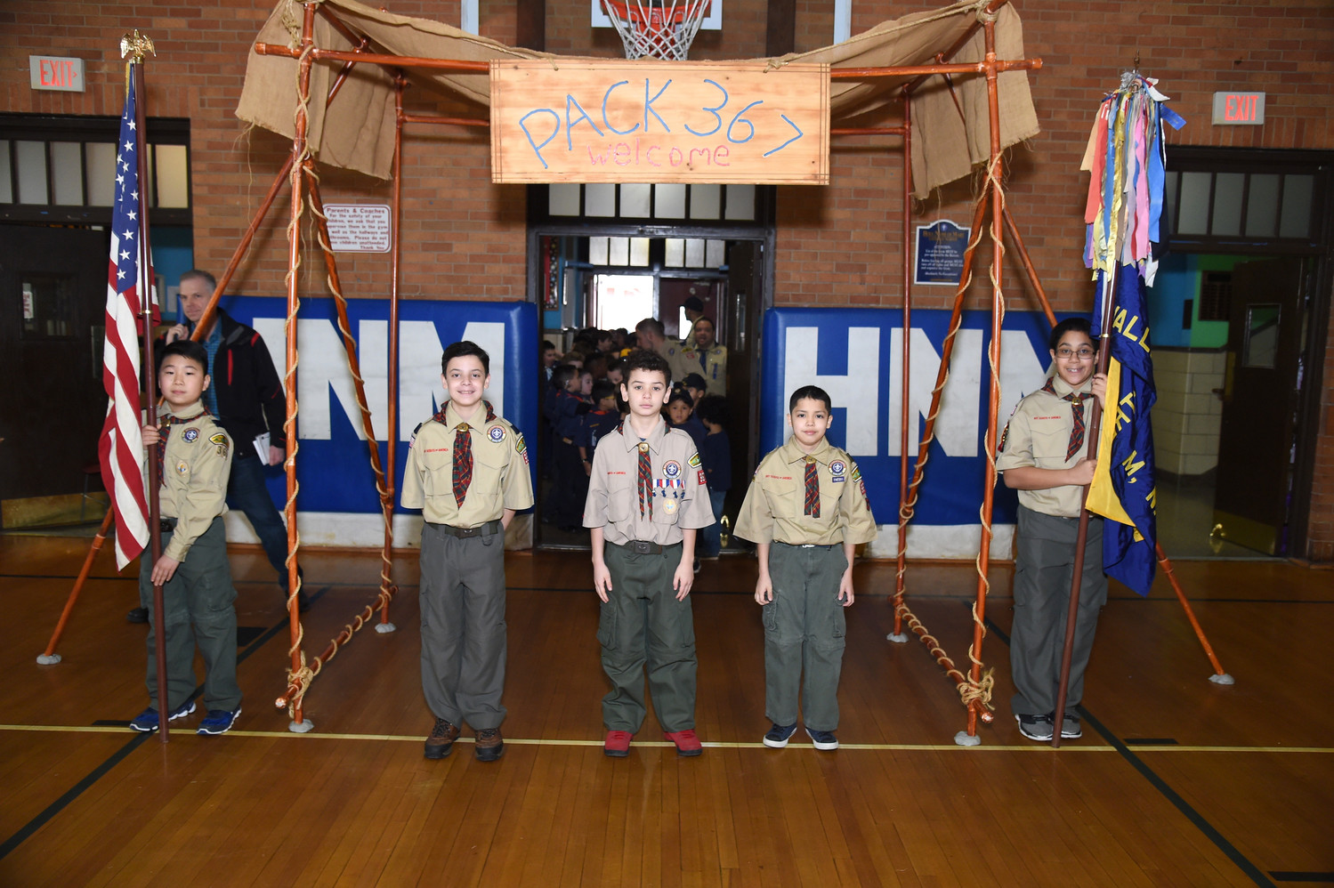 Cub Scouts Samuel Seung-Ju Na, 10; Marco A. Alvarez, 11; Logan Thomson, 10; Benjamin Charles Amirazodi, 11; and Darwin Thomas Hinson II, 10, welcomed members of Cub Scout Pack 367 to the Blue and Gold ceremony on March 3.