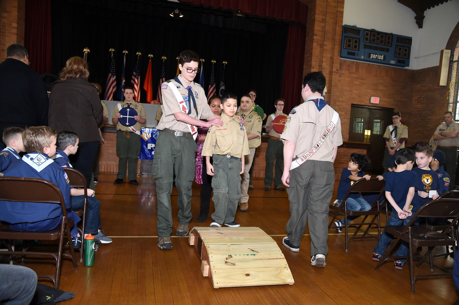 Benjamin Amirazodi, 11, bridged over to boy scouts.