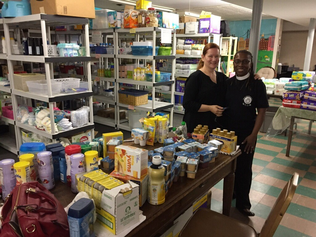 Barbara Rice Thompson, program director of the Mother and Child Ministry, left, and the Rev. Maxine Barnett, curate at the Church of St. Jude, inside the stocked pantry.