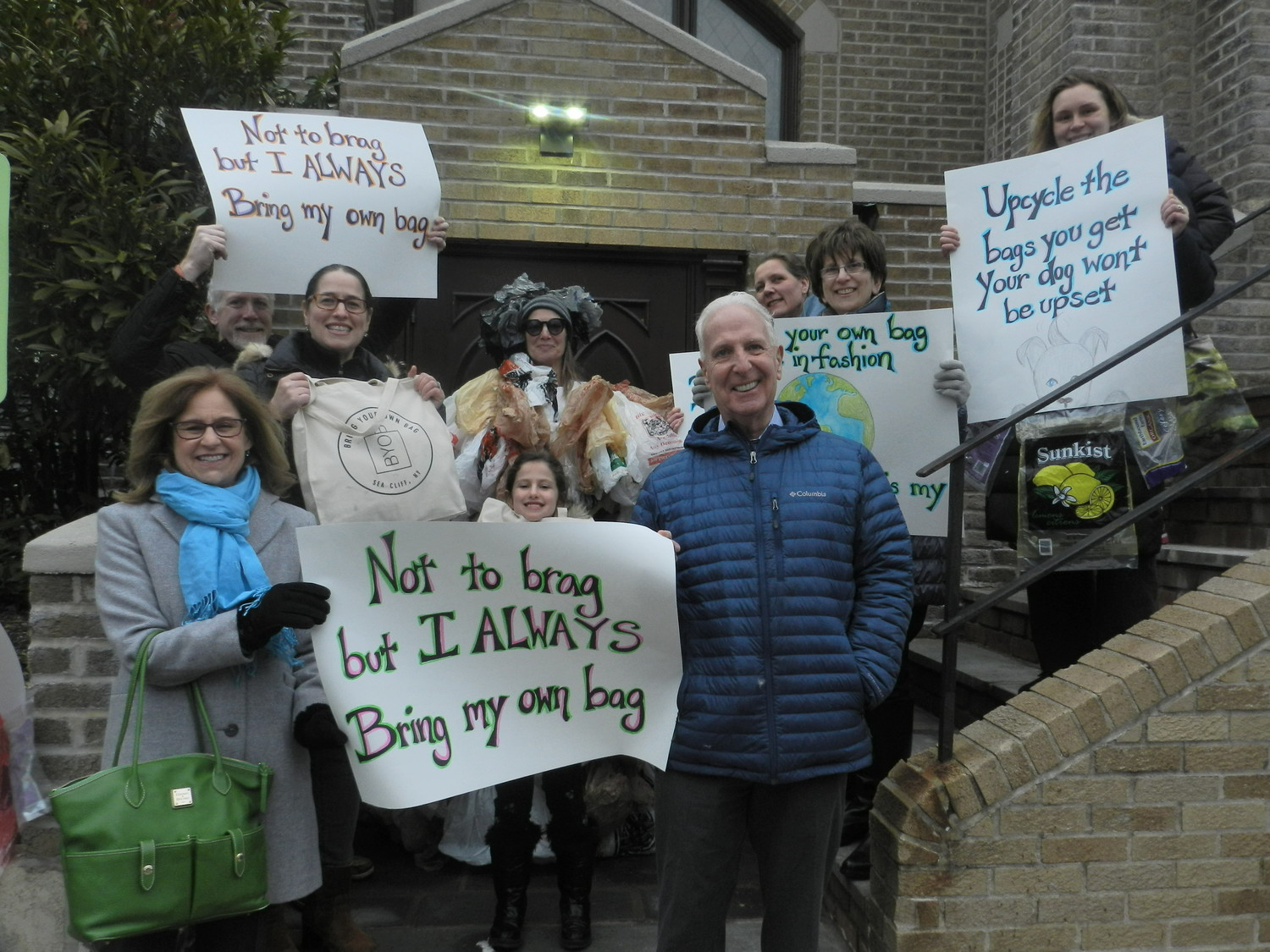 "Trustees Dina Epstein, far left, and Kevin McGilloway joined residents in support of a ""bring your own bag"" ordinance for the village."
