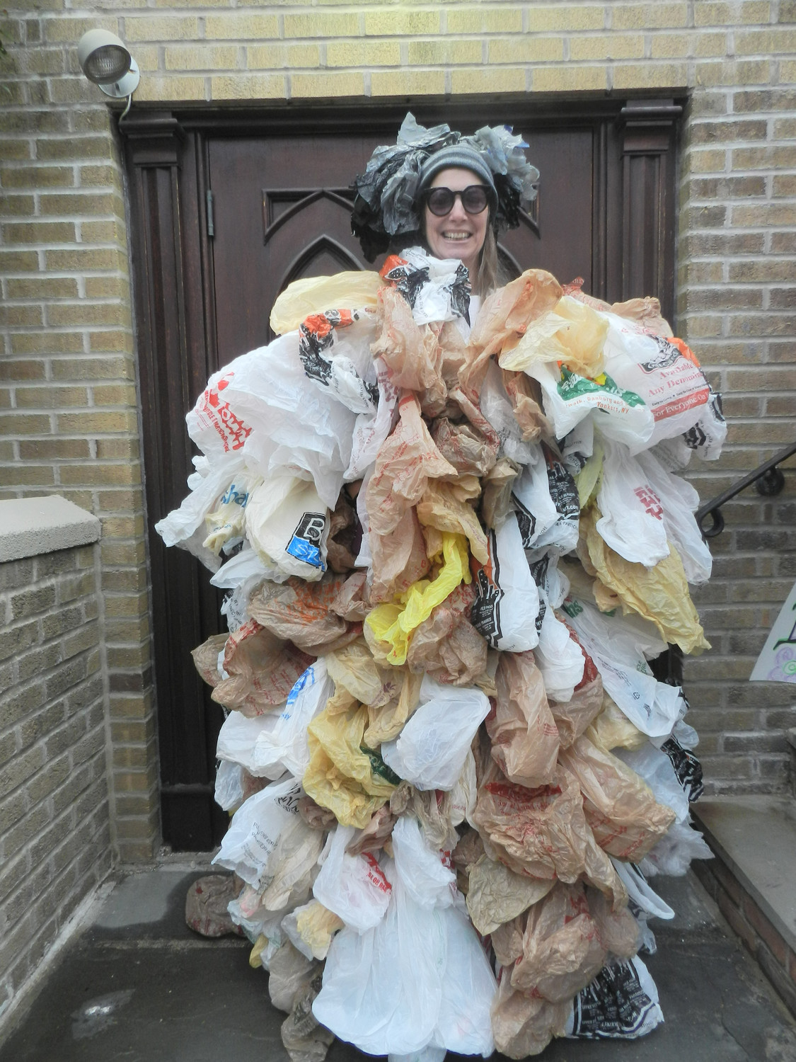 "Environmental activist Susan Brockmann, of Lynbrook, wore a ""dress"" made of 500 single-use bags, the number of bags the average person uses in a year."