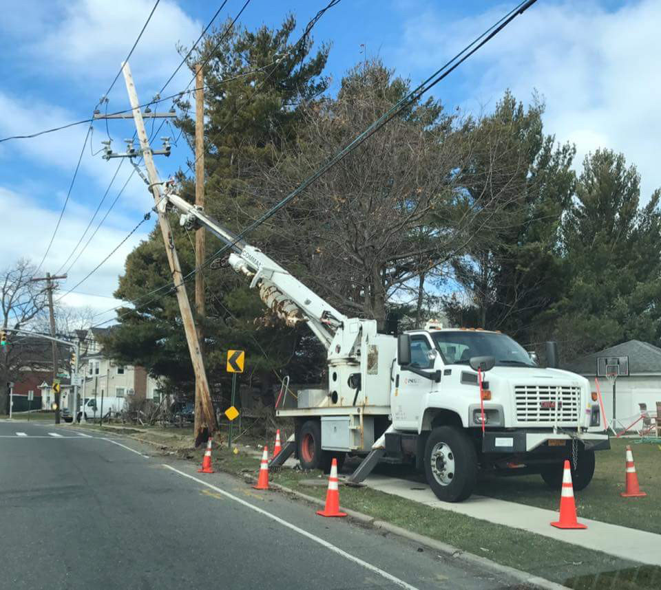 Several poles along West Broadway in the Five Towns need to be supported by its adjacent, or work trucks, such as this one near Cedarhurst Avenue in Cedarhurst.
