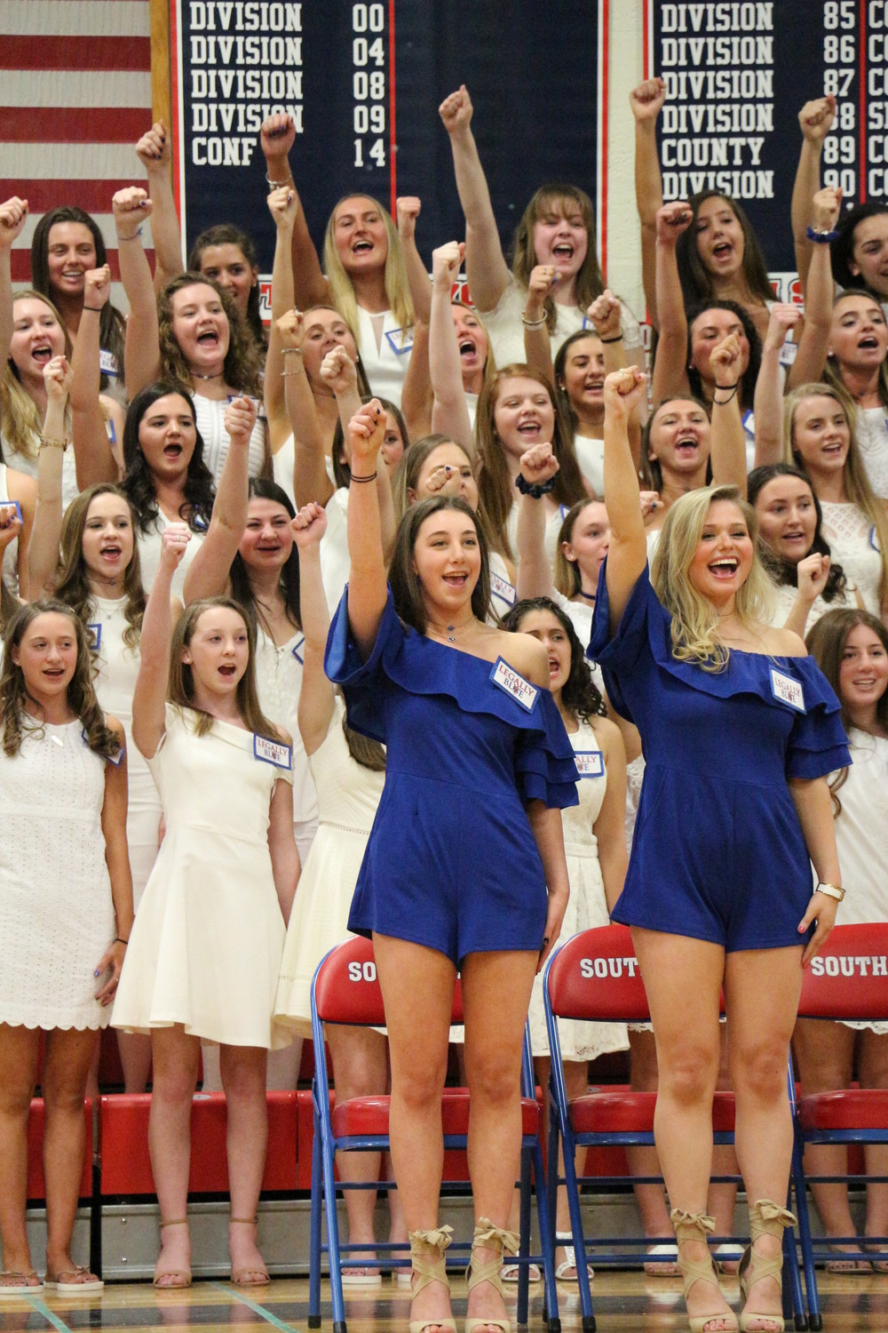 Blue captains Zoe Roman, left, and Katie Rosshirt led their team in a song.