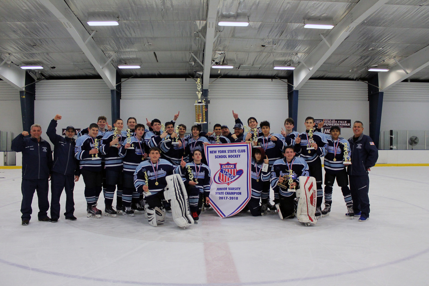 Oceanside Ice Hockey's junior varsity team celebrated its historic win minutes after securing the state championship on March 4.