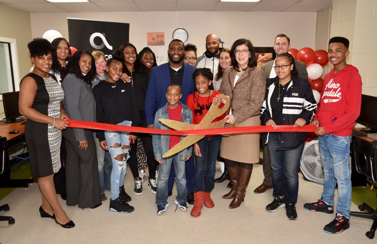 Members of the Martin Luther King Center gathered with District Attorney Madeline Singas on Feb. 14 for a ribbon cutting of the center's newly upgraded computer lab.