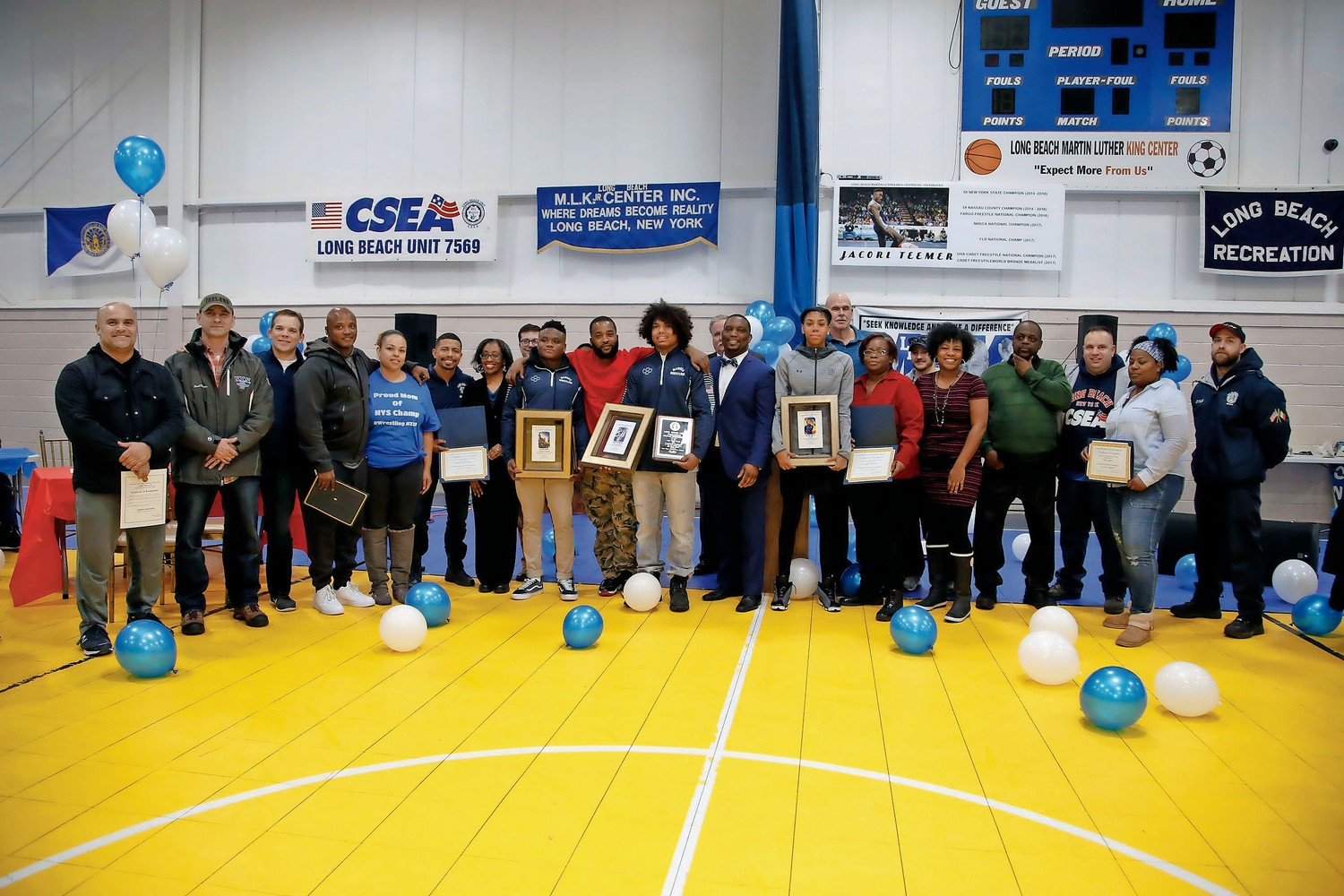 State wrestling champs Jacori Teemer and Elijah Rodriguez and star basketball player Kadaja Bailey were honored at a ceremony at the MLK Center after the parade.