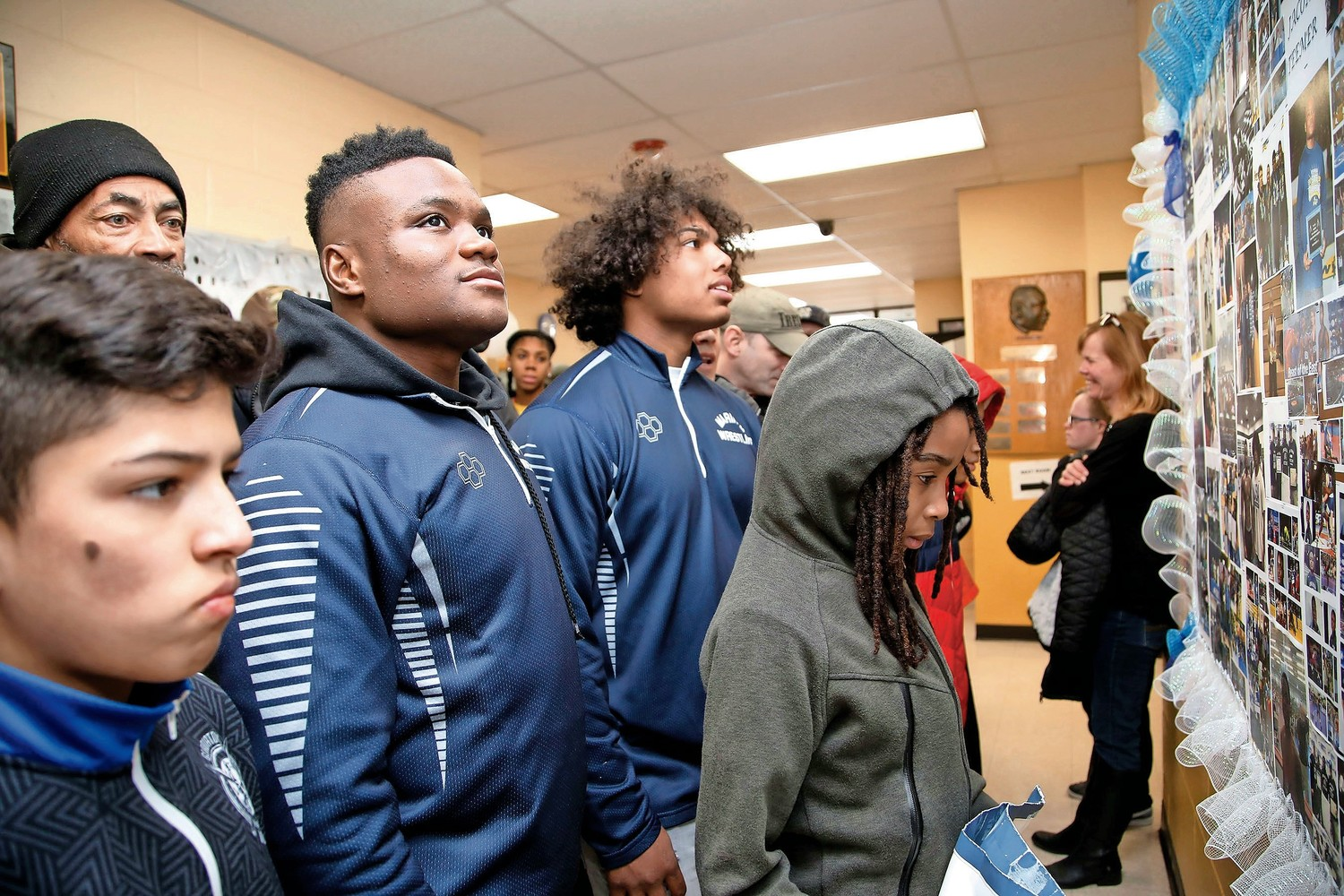 Jacori Teemer, Elijah Rodriguez and others observed the photo board honoring the two state champions.