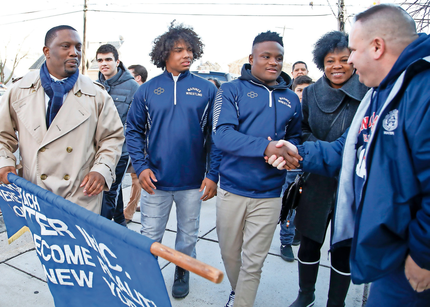 Martin Luther King Center Chairman James Hodge, far left, Elijah Rodriguez, Jacori Teemer, MLK Center Acting Director Lisa Hayes and Long Beach Civil Services Employees Association President John Mooney took part in Tuesday's parade honoring Teemer and Rodriguez for their state wrestling championship wins on Feb. 24