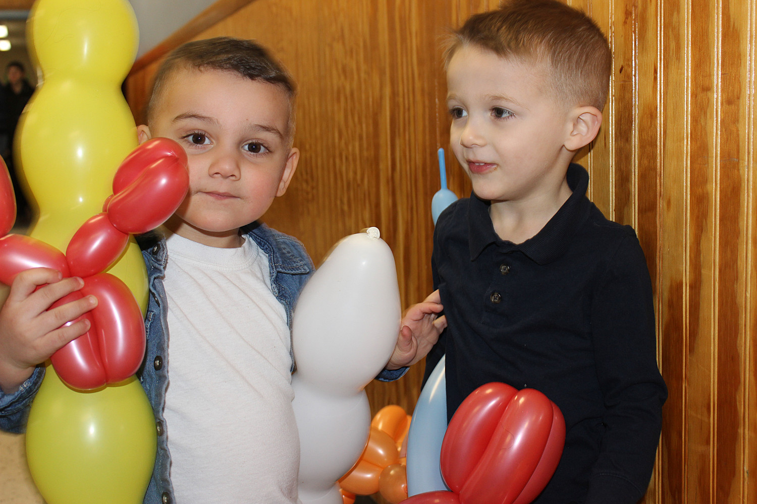Christian Krug, 2, and his cousin Graham Reinhardt, 3, made sure to get their fill of balloon animals.