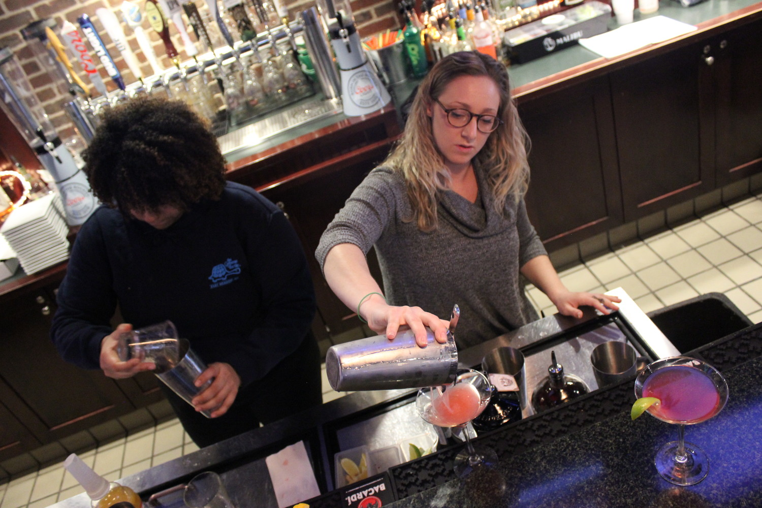 Stephanie De Los Santos, 22, left, and Michelle Baumann, 26, both of East Meadow, triumphed in the regional round of the Greene Turtle's fourth annual Bring Your Own Bartender competition and will be competing on April 13 for a chance to have one of their drinks added to the menu.